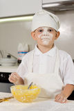 Messy young boy preparing to bake Stock Photography