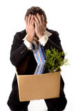 Messy Young Business Man with cardboard box Fired from Job Royalty Free Stock Photos