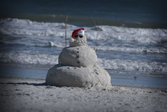 Mest bra av båda världar sand och snögubbe Fotografering för Bildbyråer