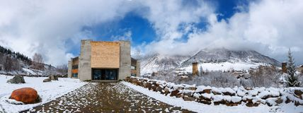 Mestia, Georgia - 25 April 2017: Panoramic view of Svaneti Museum of History and Ethnography. In Mestia, Georgia. On the right, there can be seen a typical Royalty Free Stock Image