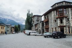 Streets of the tourist town of Mestia of the Svaneti region with classic houses surrounded by the Caucasus Mountains royalty free stock photo