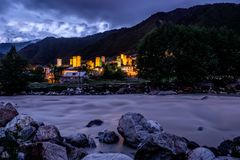 Mestia river at night. With guard towers, svaneti, Georgia royalty free stock photos
