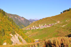 Mestia-Ushguli trek, Svaneti Georgia. A view of the village Adishi and its svan towers on the trek from Mestia to Ushguli, Svaneti region, Georgia Stock Photography