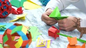 Mestieri di origami stock footage