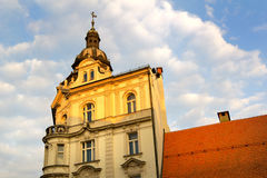 Mestna Hranilnica, Maribor, Slovenia. Neo baroque bulding on Grajski trg (Castle square). Beautiful building is lit by yellow light during sunset. Copy space royalty free stock image