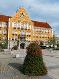 Mestsky urad / Urzad miejski Town hall , Cesky Tesin / Czeski Cieszyn, Silesia, Czech Republic. Central Europe - square and orange building of municipality stock photography