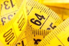 Mesure avec la mesure de bande Photographie stock