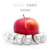 Mesure rouge de pomme et de bande Photo stock