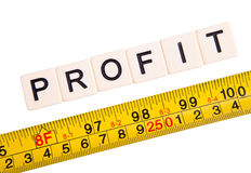 Mesure your profit. Measuring tape and word profit concept. Isolated on white stock images