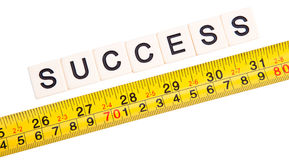 Mesure your success. Measurement of success written as word with scale isolated on white Stock Photo