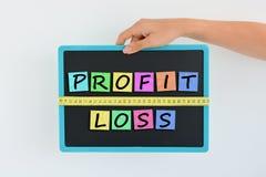 Mesurez votre bénéfice et votre concept de pertes Images libres de droits