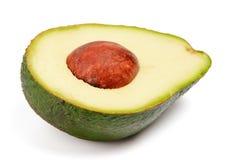 Metà dell'avocado con il pozzo Immagine Stock Libera da Diritti