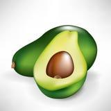 Metà dell'avocado e della frutta Fotografia Stock Libera da Diritti
