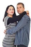 Metà di abbracciare adulto delle coppie Immagini Stock