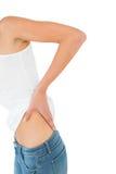 Metà di sezione di una donna che soffre dal dolore alla schiena Fotografia Stock