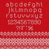 Met de hand gemaakt gebreid abstract patroon als achtergrond met alfabet, lowe Stock Foto