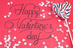 Met de hand geschreven Valentijnskaartenkaart en een lolly Stock Foto's