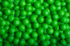 Met een laag bedekt groen suikergoed Stock Foto's