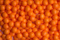 Met een laag bedekt oranje suikergoed Royalty-vrije Stock Foto's