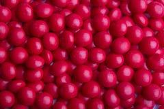 Met een laag bedekt rood suikergoed Stock Afbeeldingen