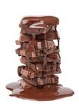 Met een laag bedekte de stukken van de chocolade stock foto