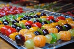 Met een laag bedekte fruitsuiker Stock Foto