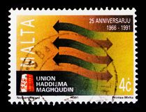 Met elkaar verbindende Pijlen, 25ste Anniv van Unie Haddiema Maghqudin serie, circa 1991 Stock Foto