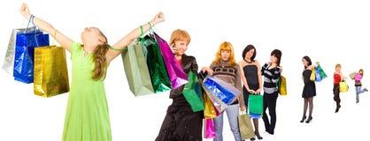 met en sac des achats colorés de gens de groupe Photo libre de droits