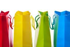 met en sac des achats colorés lumineux Photos stock