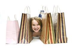 met en sac des achats de fille d'adolescent Images libres de droits