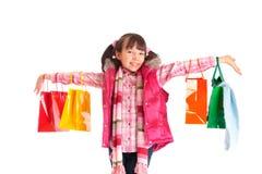 met en sac des achats de girlwith Photographie stock libre de droits