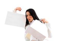 met en sac des achats de verticale affichant le femme Photographie stock libre de droits