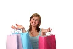 met en sac les jeunes heureux de femme d'achats Images libres de droits