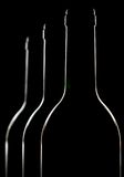 met le vin en bouteille du rouge trois Photos stock
