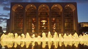 Met Opera. Metropolitan Opera at Lincoln Center in Manhattan seen at dusk with fountain in front stock photography