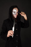 Met twee aangezichten heks die het mes en het grimas houdt Royalty-vrije Stock Foto