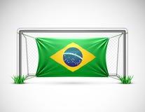 Meta del fútbol con la bandera el Brasil Fotos de archivo