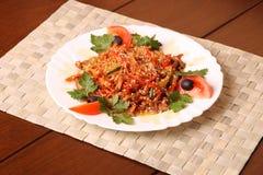 Meta met tomaat Stock Foto