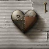 Metaal hersteld hart met sleutel op oude document achtergrond stock afbeeldingen