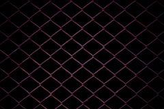 Metaal Mesh Fence op zwarte achtergrond Royalty-vrije Stock Afbeelding