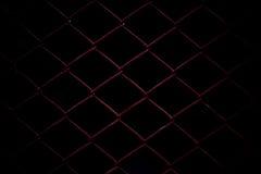 Metaal Mesh Fence op zwarte achtergrond Royalty-vrije Stock Fotografie