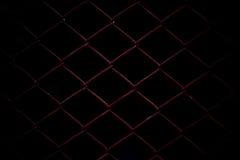 Metaal Mesh Fence op zwarte achtergrond Stock Afbeelding
