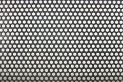 Metaal met gatenachtergrond Stock Foto