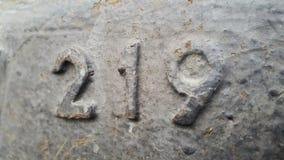 Metaal nummer 219 Textuur van roestig metaal in de vorm van cijfers 219 Stock Afbeelding