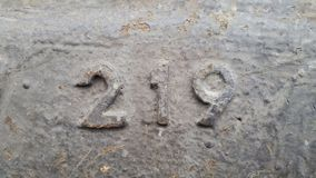 Metaal nummer 219 Textuur van roestig metaal in de vorm van cijfers 219 Royalty-vrije Stock Afbeeldingen