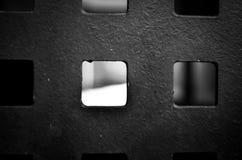 Metaal vierkant patroon met erachter licht stock afbeeldingen