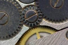 Metaalachtergrond met metaaltandraderen een uurwerk Macro Stock Afbeelding