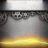 Metaalachtergrond met tandradtoestellen en elektrische bliksem Royalty-vrije Stock Afbeelding
