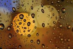 Metaalblikken zoals regendruppels backlight kleuren stock foto's