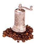 Metaalkoffiemolen op wit wordt geïsoleerd dat royalty-vrije stock foto's
